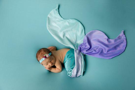 Newborn dressed up as a mermaid