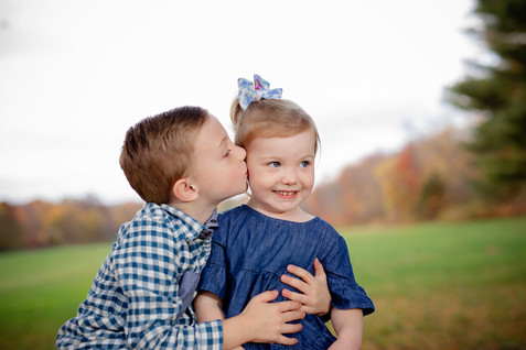 Brother kissing sister on cheek