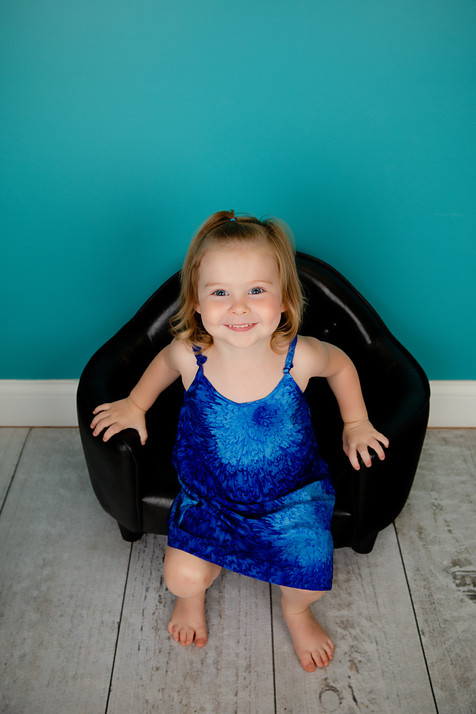Child girl wearing a blue dress