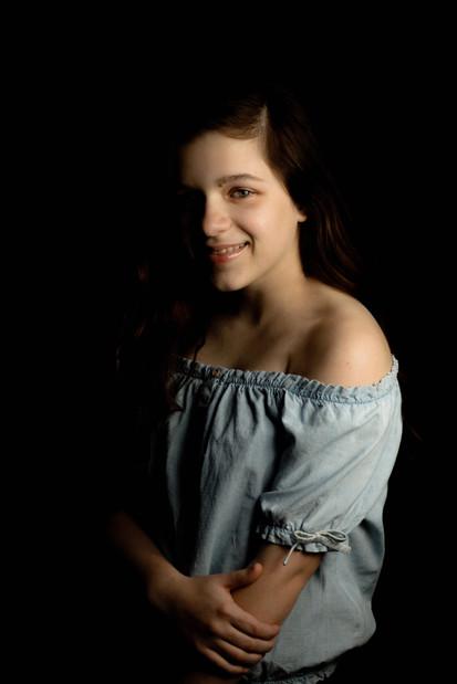 Teen girl wearing blue hand on arm