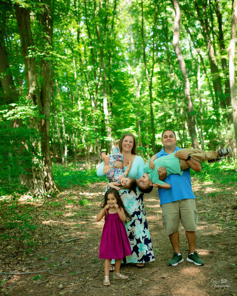 family of five three girls walking trail