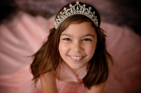Young girl wearing pink dress and tiara