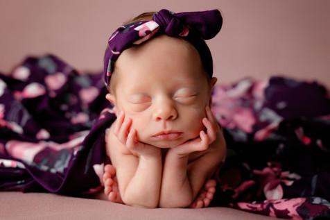 Preemie newborn with purple handband