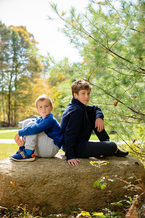 Two brothers sitting on a rock