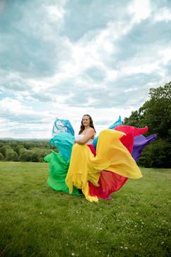 woman wearing rainbow baby dress