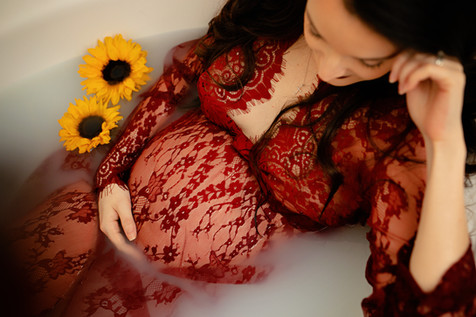 pregant lady in tub wearing lace red