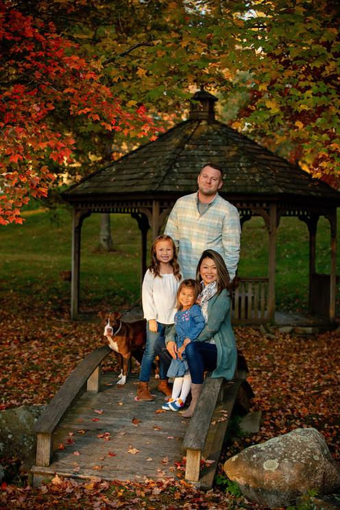 Family on a bridge with pitbull