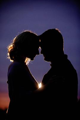 Couple Silhouette at sunset purple sky