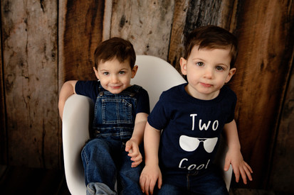 Two twin brothers sitting together