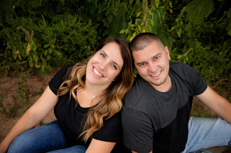 couple sitting down heads together smiling