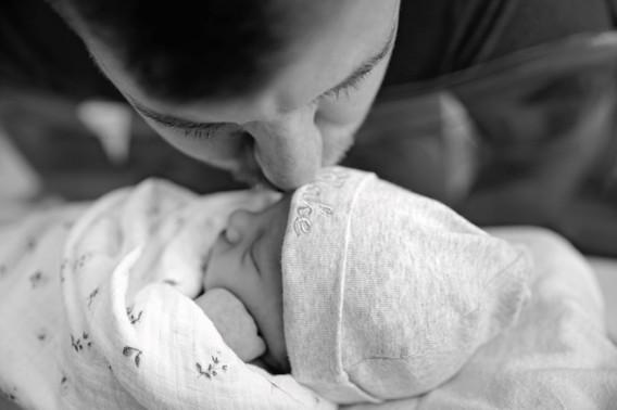 Newborn being kissed in hospital