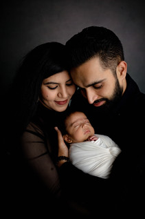 Parents hold newborn in arms