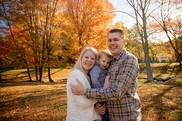 Family of 3 with fall foliage