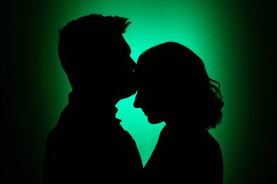 Couple engagement silhouette with green background