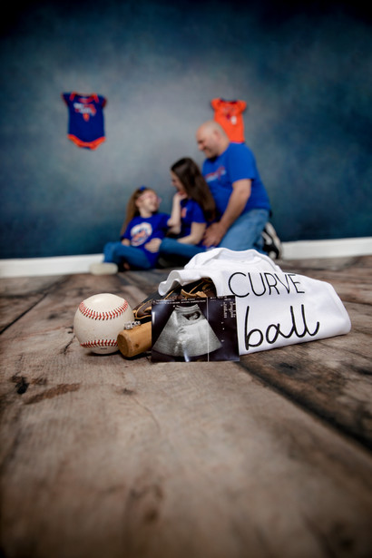 pregnancy reveal with parents and daughter baseball theme