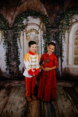 young boy and girl dressed as prince and princess