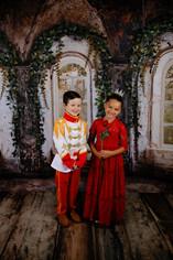 young boy and girl dressed as prince and princess