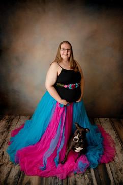 rainbow baby posing with dog