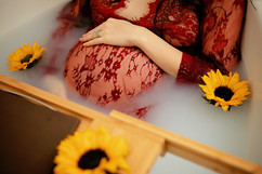 pregnant belly wearing red inside a tub