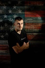 Senoir guy spot light in front of american flag