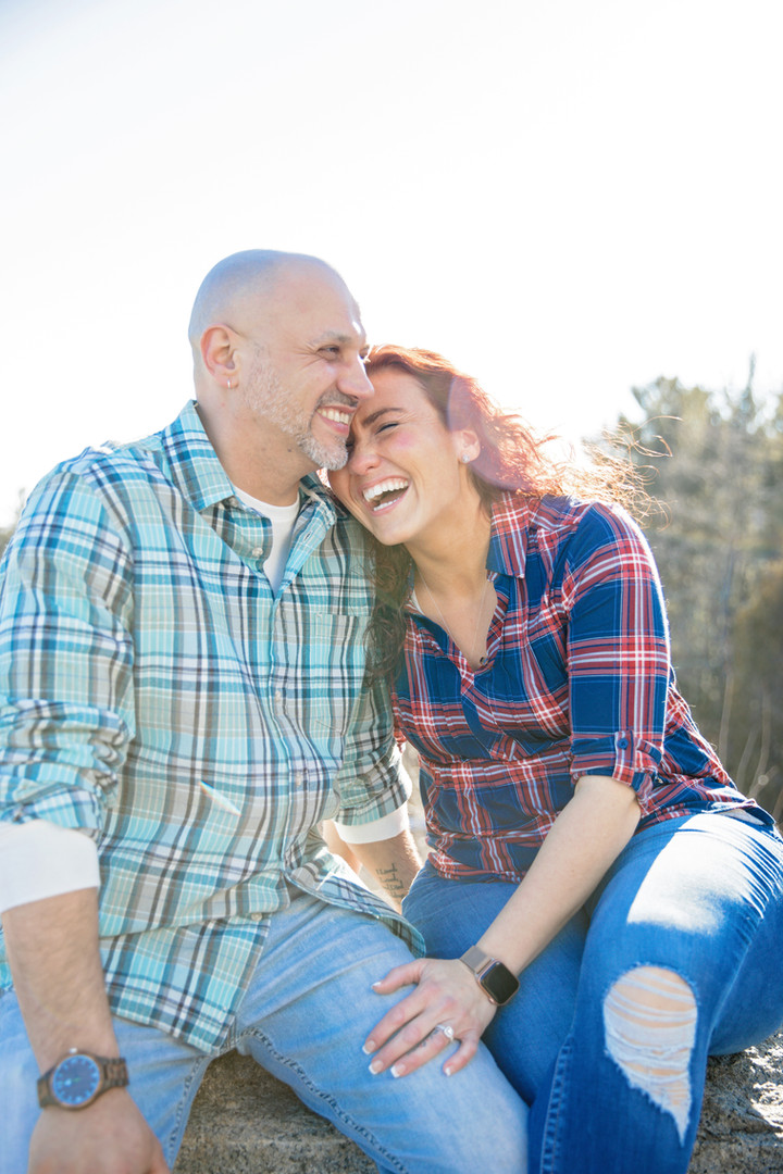 couple in plaid shirts laughing