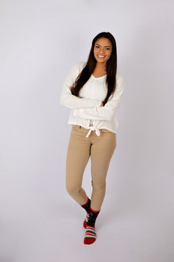 Teen girl with long dark hair arns crossed with white background