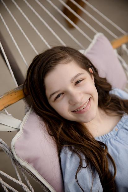 Teen girl laying in hammock