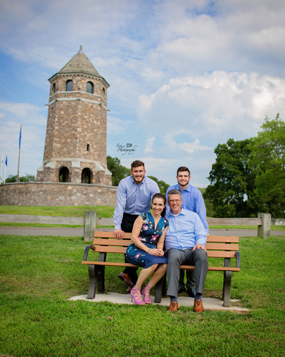 family of four two sons sat on bench