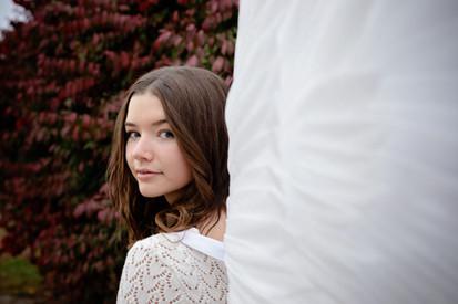 Teen girl wearing wings