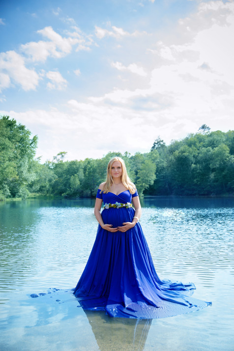 pregnant women wearing blue standing in water