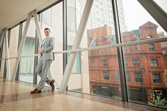 business shoot with man leaning on wall