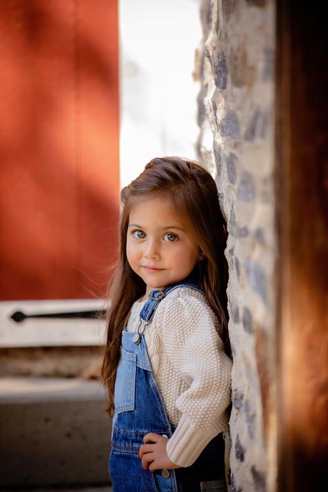 Little girl on rock wall