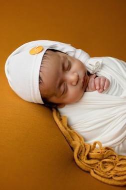 Sleeping newborn with sleeping hat yellow gold