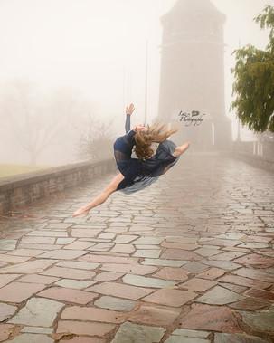 Gymnastics jump outside in fog