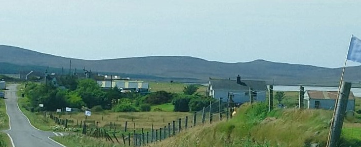 White flags on route of bride and groom to church, North Uist