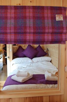 Main bedroom at rear of pod.