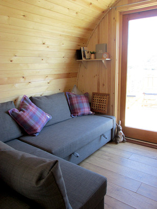 Seating area which converts into a double bed creating space for 4 guests.