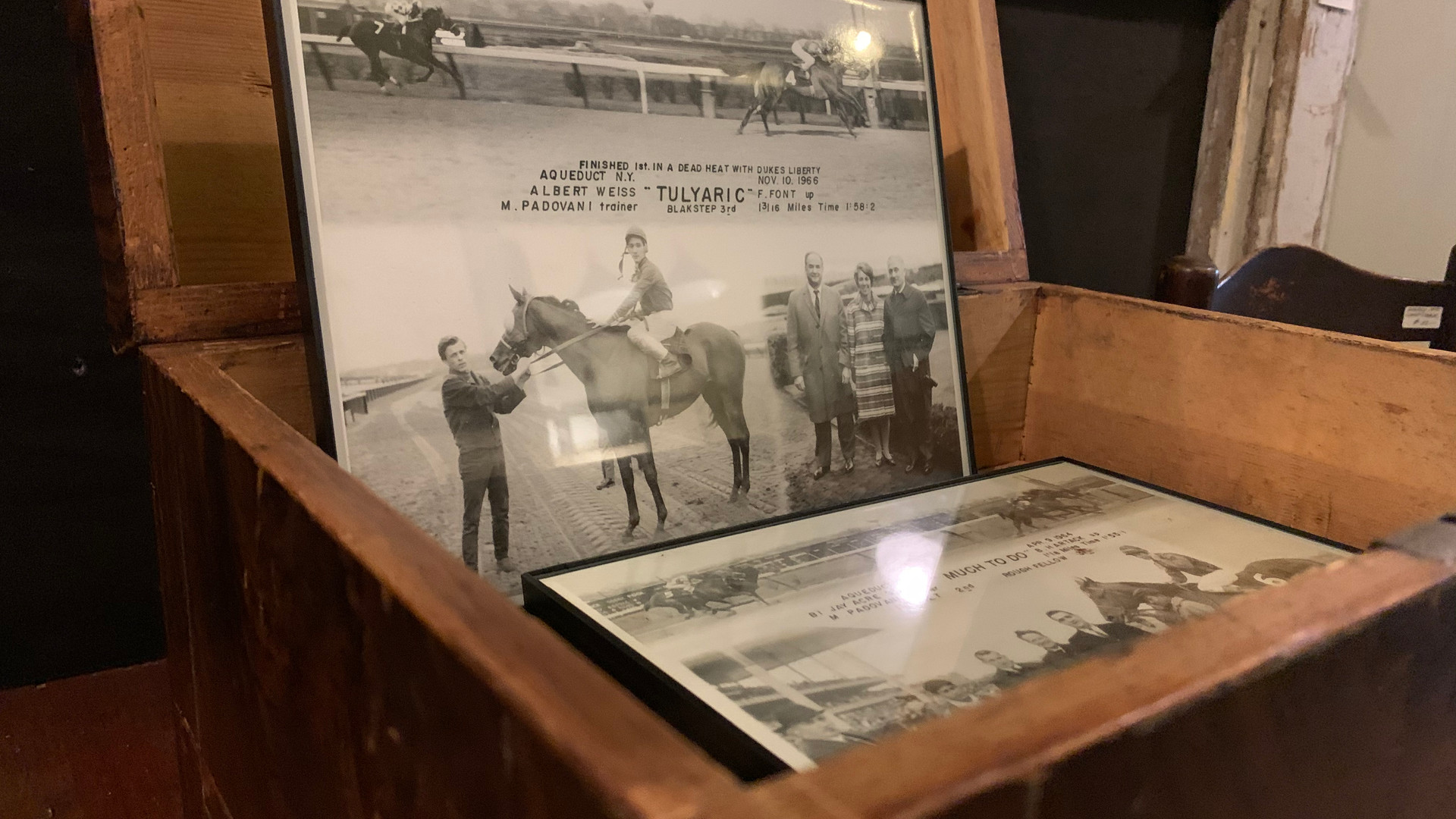 antique horse racing photograph sits inside a wooden box