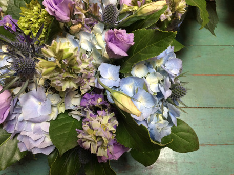 Blue hydrangea, hyscynth and sea holly.