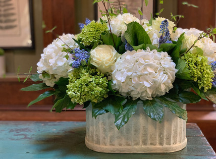 Large hydrangea and rose arrangemet in customer's container