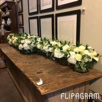 Wedding table arrangements lined up as we make 'em