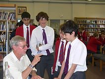 David Hill, author signing books at a local school