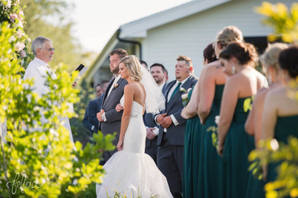 Outdoor wedding ceremony at Eighteen Ninety Event Space in Kansas City, Missour.   Photo by Felicia the Photographer.