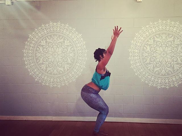 """a black woman is standing in the yoga posture """"utkatasana"""""""
