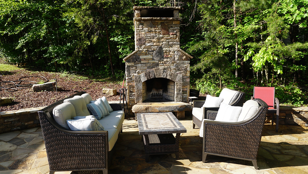 stack stone fireplace and outdoor living area