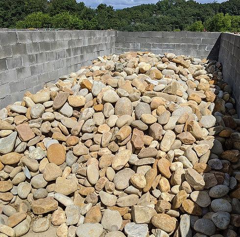 river rock bulk in bin 1000x1000.jpg