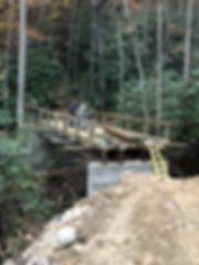 Creek Bridge spannig waterway for vehicle crossing