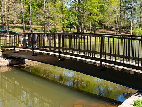 wedding bridge two guys working on it mo