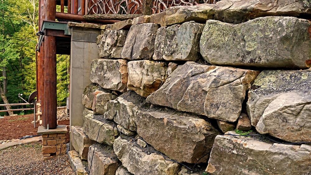 Natural stone boulder retaining wall at residence