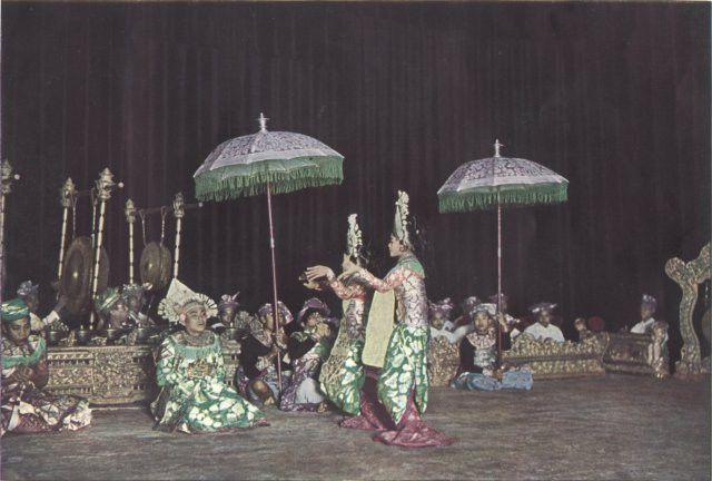 Balinese folk dancers performing in the Theatre of the Dutch Indies c. 1931.